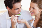 Smiling couple enjoys cooking together — Stock Photo