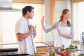 Couple arguing in the kitchen — Stock Photo