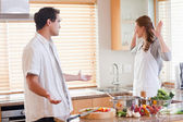 Couple disputing in the kitchen — Stock Photo