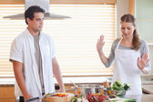 Couple having a disagreement in the kitchen — Stock Photo