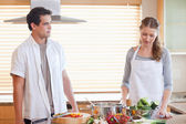 Couple having a tensed situation in the kitchen — Stock Photo