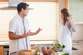 Couple has a tensed situation in the kitchen — Stock Photo