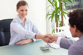 Consultant shaking hands with her client — Stock fotografie