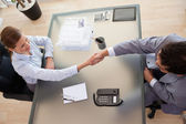 Above view of consultant shaking hands with customer — Стоковое фото