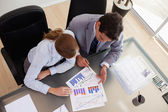 Above view of consultant analyzing data with her client — Stock Photo