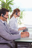 Hotline employees at work — Stock Photo