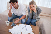 Worried couple doing their accounting — Stock Photo