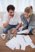 Portrait of a worried young couple doing their accounting — Stock Photo