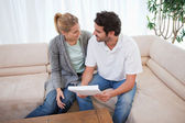 Young couple reading a letter — Stock Photo
