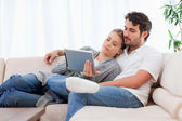 Lovely couple using a tablet computer — Stock Photo