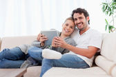 Happy young couple using a tablet computer — Stock Photo