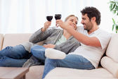 Young couple having a glass of wine — Stock Photo