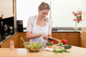 Woman slicing vegetables — Stock Photo