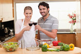 Couple drinking a glass of red wine — Stock Photo