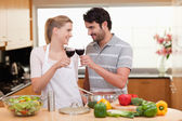 Lovely couple drinking a glass of wine — Stock Photo