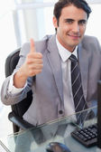 Portrait of a businessman working with a computer with the thumb — Stock Photo