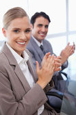Portrait of a smiling business team applauding — Stock Photo