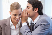 Businessman whispering something to his colleague — Stock Photo