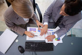 Serisous business team studying statistics — Stock Photo