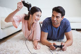 Woman beating her fiance while playing video games — Stock Photo