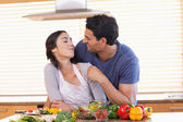Man feeding his fiance — Stock Photo