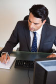 Portrait of a businessman taking notes — Stock Photo