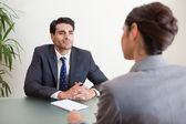 Handsome manager interviewing a female applicant — Stock Photo