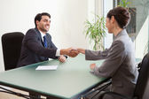 Smiling manager interviewing a good looking applicant — Stock Photo