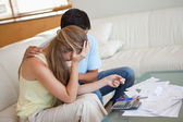 Sad couple in financial trouble — Stock Photo