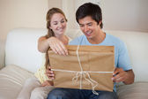 Couple opening a package — Stock Photo