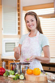 Portrait of a smiling woman cooking — Stock Photo