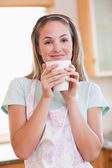 Portrait of a quiet woman drinking a cup of coffee — Stock Photo