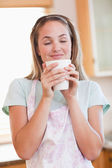 Portrait of a quiet woman drinking a cup of tea — Stock Photo