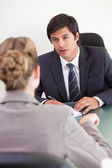 Portrait of a serious manager interviewing a female applicant — Stock Photo