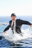 Portrait of a businessman going out of the water — Stock Photo