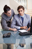 Businesswoman mentoring her new colleague — Stock Photo