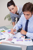Business team analyzing statistics together — Stock Photo