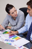 Business team talking about statistics — Stock Photo