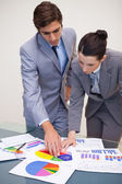 Consultant and customer looking at statistics — Stock Photo