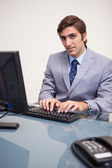 Businessman typing on his keyboard — Stock Photo