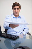 Businessman handing over paperwork — Stock Photo