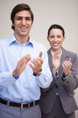 Standing business team clapping — Stock Photo