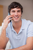 Smiling man on the cellphone — Stock Photo