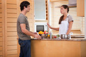 Couple talking in the kitchen — Stock Photo