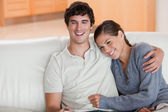 Happy couple enjoying their time together on the sofa — Stock Photo