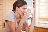 Side view of woman drinking coffee — Stock Photo