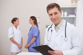 Doctor standing in examination room — Stock Photo