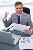 Businessman celebrating market research results — Stock Photo