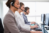 Side view of customer service assistants — Stock Photo