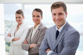 Marketing department with arms folded — Stock Photo